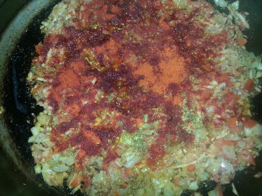 Add Kashmiri mirch, coriander_cumin powder and turmeric powder