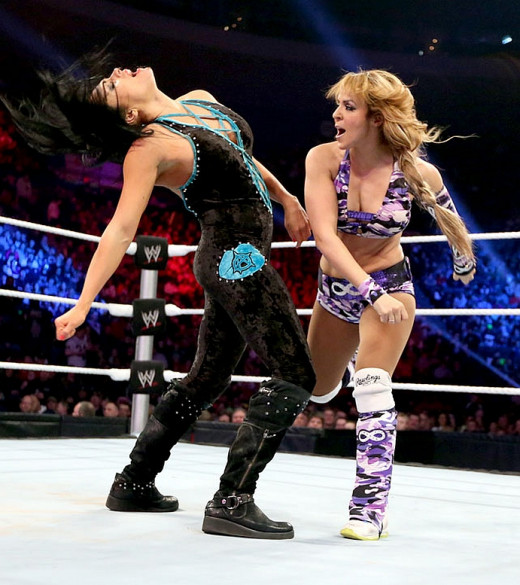 Layla belts Aksana. Not really digging Layla's blond hair.
