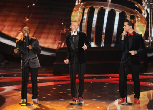"From left, Burnell Taylor, Devin Velez and Lazaro Arbos perform on ""American Idol."""