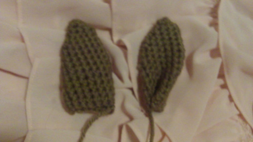 Unsewn ear with curved sewn ear.