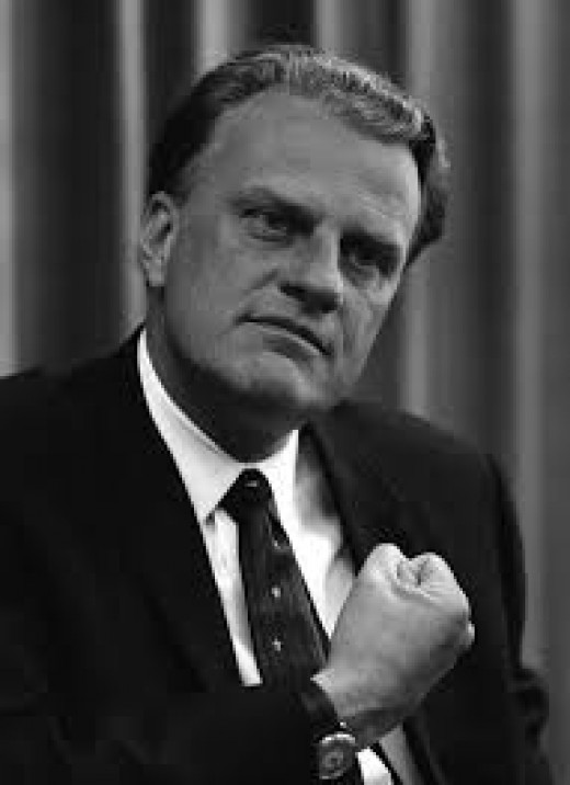 Billy Graham, using a fist-on-chest Freemason sign.