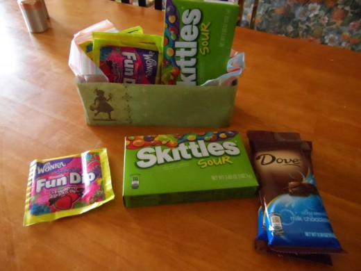A few candies, sours, fun dip and a chocolate bar.