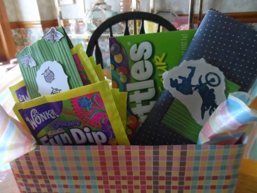 Teen boy Easter basket. Candy bar covered in designer paper, decorative label for the fun dip and tissue paper lines the bottom of the box