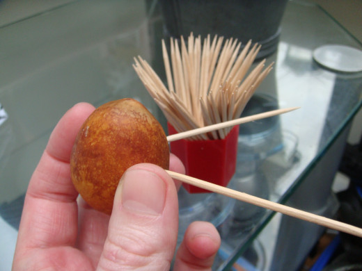 Put cocktail sticks into the pit