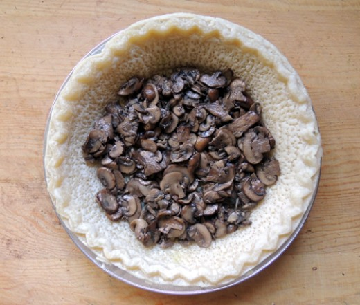 layer veggies into pie shell, starting with mushrooms
