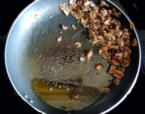 tilt pan, and drain oil from mushrooms