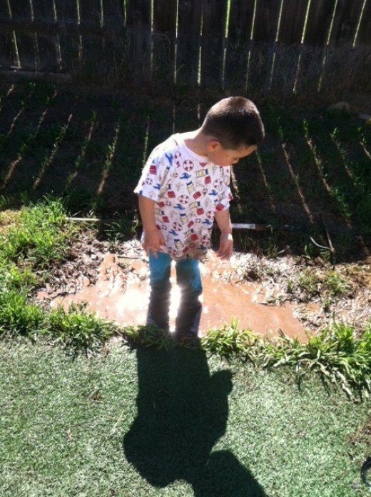 I try nowadays to teach my children that the best toys are not store bought but made of imagination. This puddle was a big ocean later on.