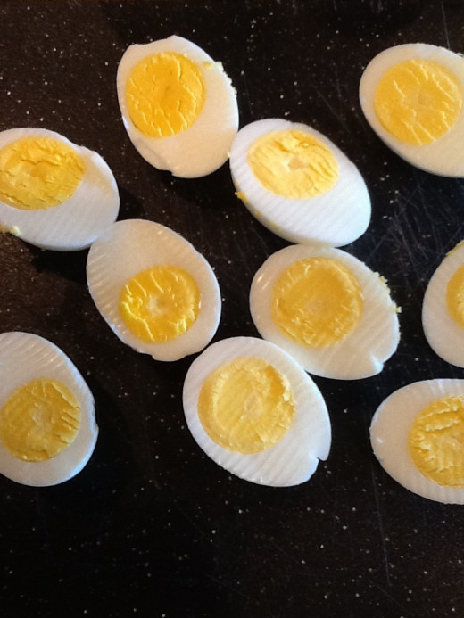 Sliced hard boiled eggs, centers perfectly cooked.