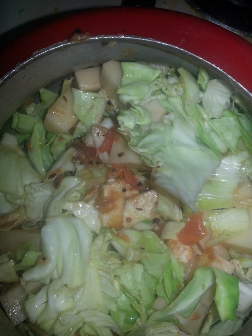 Add cabbage and potato