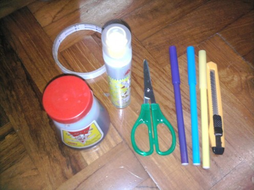 glue, double-sided tape, a pair of scissors, markers, pencil, penknife...
