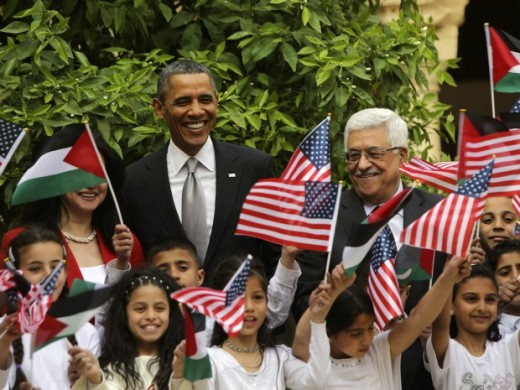 President Barack Obama poses with Palestinian kids during a visit to the Church of the Nativity with Palestinian President Mahmoud Abbas in Bethlehem