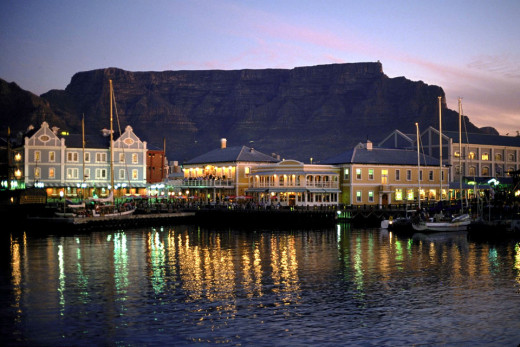 Victoria and Alfred Waterfront - Cape Town - at night. This is when the music and vibrant night life lights up the marina.