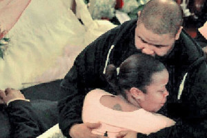 Couple Reggie Wade and Monique McMillan exchanged I dos on the tomb of their dead uncle