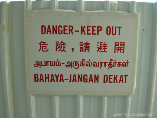 Signboards in Singapore are usually written in 4 languages: English, Chinese, Tamil and Malay, to accommodate the main races in the country.
