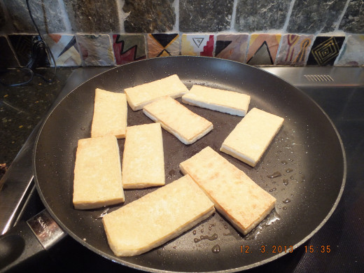 While the sauce is simmering, start to brown your tofu.