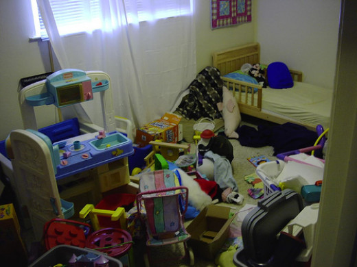A kid's room in serious need of some cleaning.
