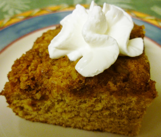 Piece of Spice Cake with a dollop of whipped cream.