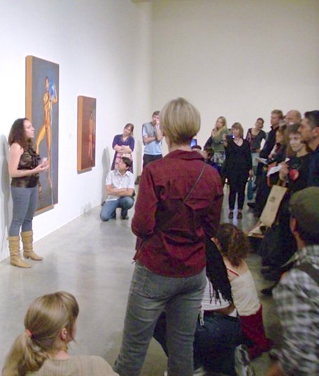 Artists often give talks about their work. Check art museums' schedule of events to find out when you should go. Photo of Corinna Nicole giving an artist talk at the Berkeley Museum of Art. Courtesy of Sandie Yi.