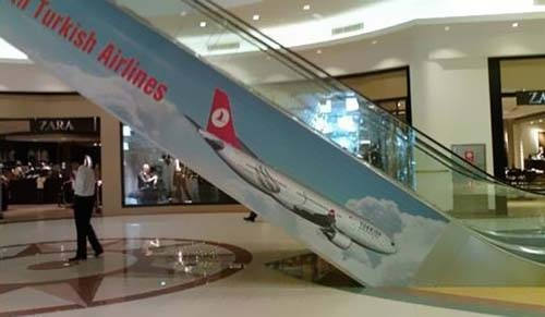A miss positioned Ad from Turkish Airlines on a mall escalator gives the impression their planes fly downwards.