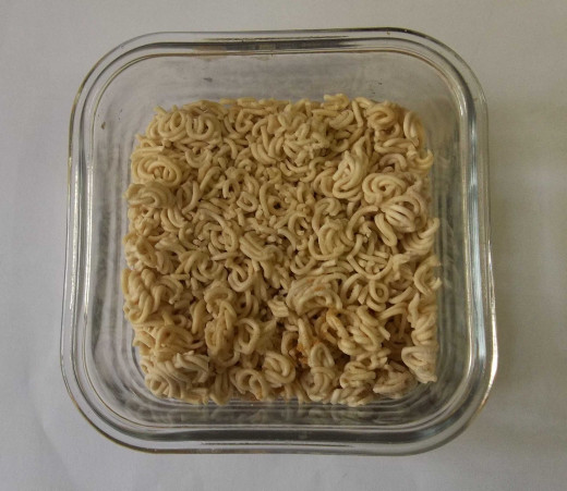 Put the noodles in a microwave-safe dish. This one is thick glassware