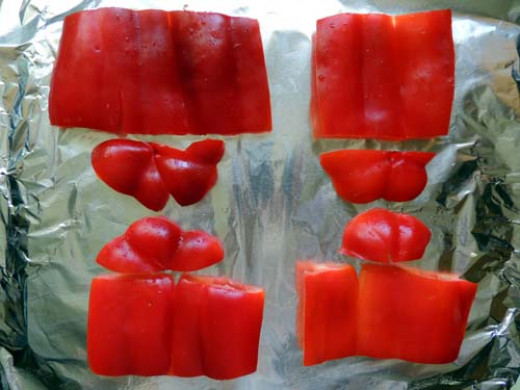 slice, seed and flatten peppers onto foil
