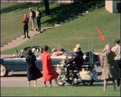 The Babushka Lady as JFK is struck by bullets.