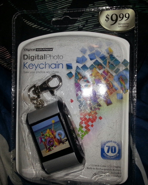 I bought this digital keychain that stores 70 pictures. I am downloading several of my daughter's baby bump pictures and all of the ultrasound pictures and putting it in the Babys First Year Memory Jar.