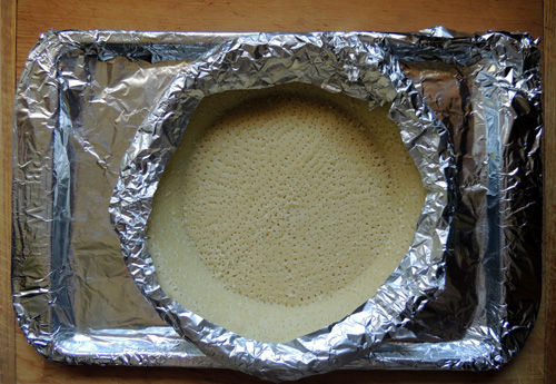 edge crust in foil, bake at 400 for 7 minutes for crispy crust - skip this step if you prefer a more doughy crust