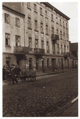 This is from Ghetto Litzmannstadt: Men haul a cart down the street.