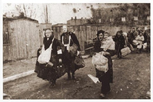 People being deported, had to take whatever they could carry with them.  These are residents from Ghetto Litzmannstadt.  They are heading towards the trains that will take them to Chelmno.