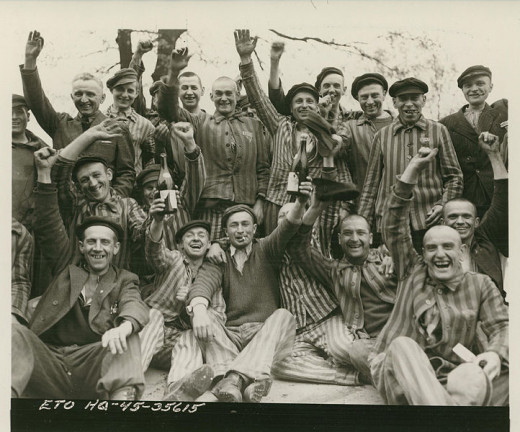 Rescued from Dachau.  They are toasting to their liberators.  This is amazing, and might be one of my favorite photos ever taken, of all time.