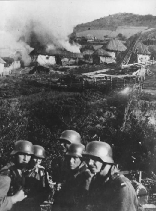Taken 1941, Germans set fire to a Serbian village near Kosovska Mitrovica.