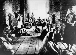"Children and mothers, 1942- 1045. imprisoned in the ""Kula"", or tower, of Stara Gradiska concentration camp."