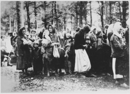 Yugoslavian women and children in a wooded area, about to get deported.  It is hard to fathom what they went through.