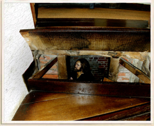 The stairs at Harvington Hall lift up to reveal a secret priest hole underneath.
