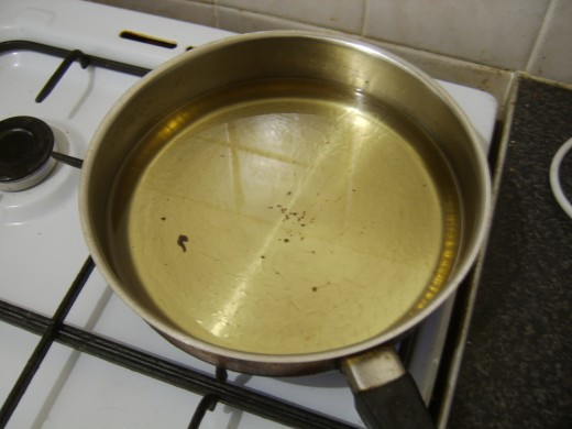 Vegetable oil in deep frying pan for frying chicken