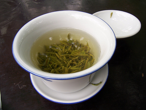 Drink a cup of green tea to bring more $$$ into your life.