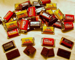 Does anyone know how much one Hershey's chocolate miniature weighs? One ounce? Half an ounce?