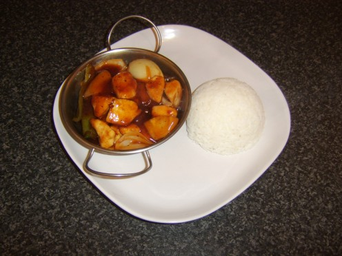Wok prepared sweet and sour chicken with a side serving of simple boiled rice
