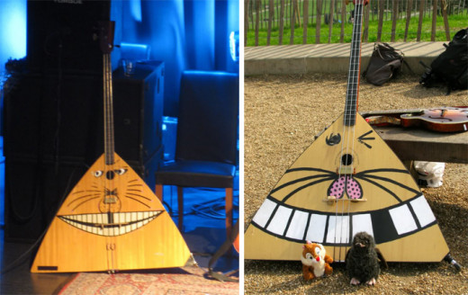 On the left is Borge, who was the original cat-faced contrabass balalaika for Katzenjammer, until he became too frayed to play. They then introduced Akero, pictured right, as a replacement (although Borge will always be in their hearts.)