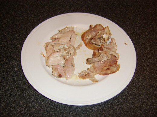 Skin is removed from the chicken thighs and meat plucked from the bones