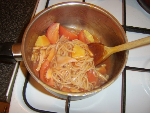 Tomato and pineapple are added to sweet and sour sauce