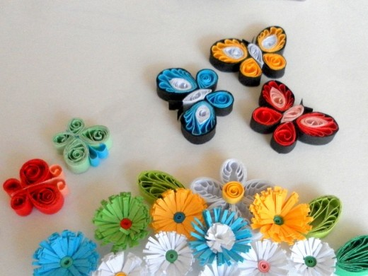 Paper quilling butterflies and flowers