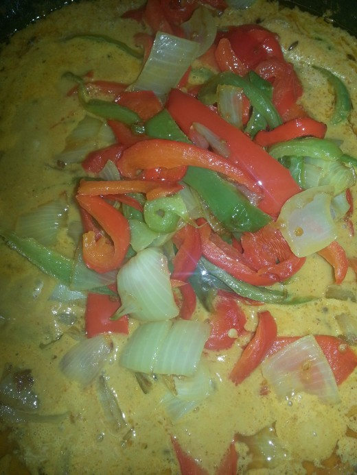Add in the fried onion and capsicum and mix well