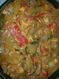 Paneer tikka masala - Cottage Cheese dipped in Sour cream, cooked with Capsicum, Onion and Tomatoes
