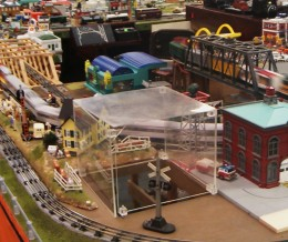 This acrylic (Plexiglass) cube is part of a train layout. The top became cloudy due to cleaning with the wrong product.