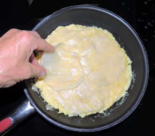once mixture is somewhat set, layer provolone slices
