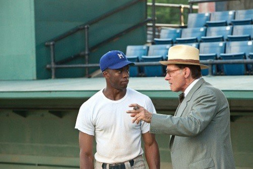 Chadwick Boseman plays the legendary Jackie Robinson and Harrison Ford stars as the equally legendary Branch Rickey in the uplifting and spirited baseball pic 42