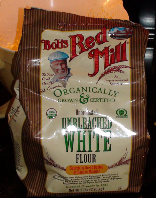 Bob's Red Mill is one of my favorite organic brands. They guarantee their seeds are not genetically modified. They do warn that they cannot account for wind drift or pollinators.
