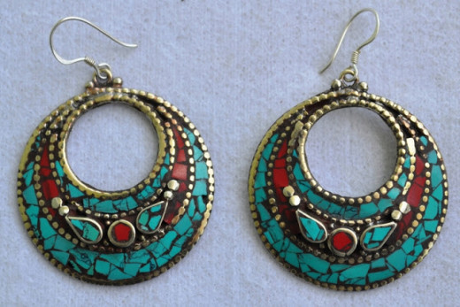 A moon shape earring crafted with turquoise and coral stone 1.75 inch daimeter 1.5 inch height and carefully crafted. elegant wearing and antique looks.